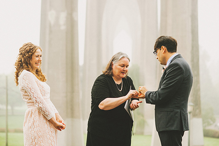 officiant giving groom rings