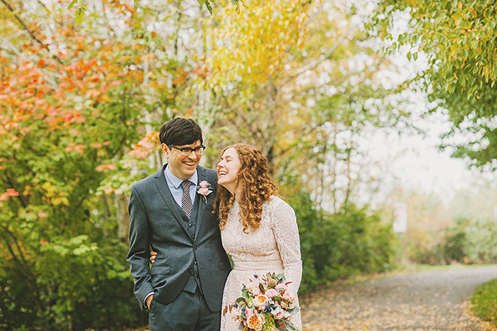 bride and groom walking in cathedral park