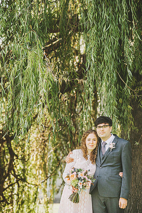 bride and groom under weeping willow