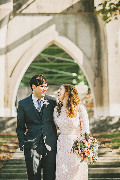 bride and groom in cathedral park