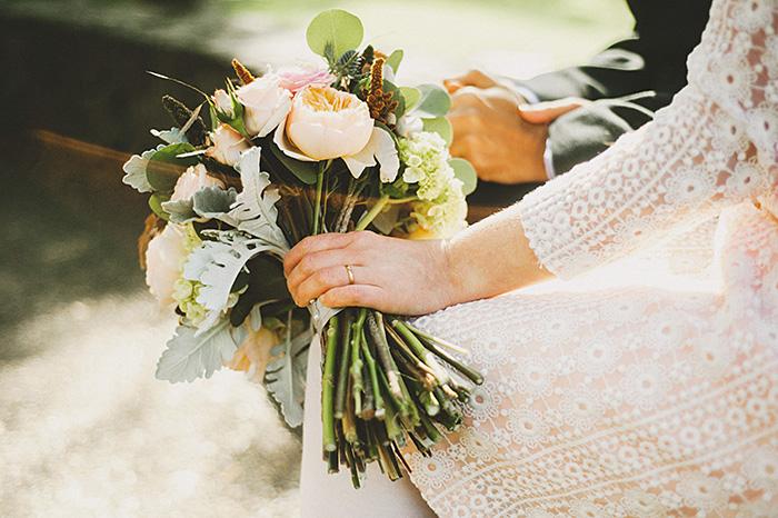 bride with rose wedding bouquet