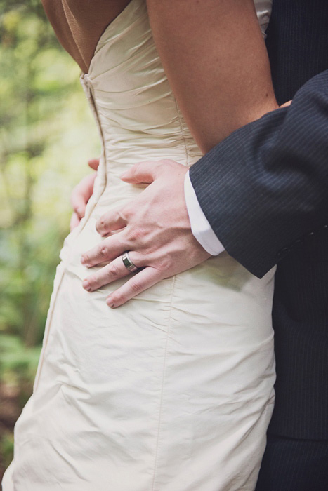 groom's hands on bride's hips