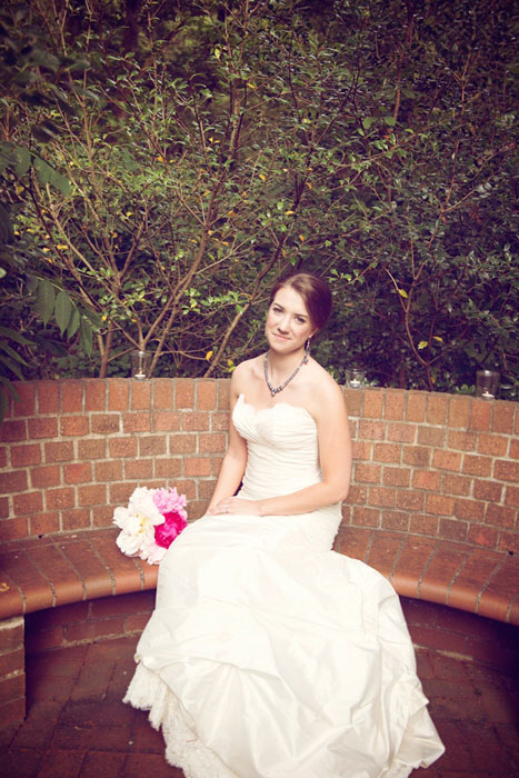 bride portrait sitting on bench