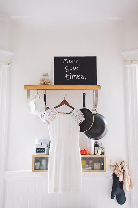 short lace wedding dress hanging up