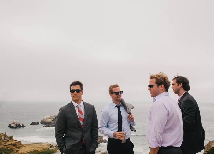 groomsmen by the sea