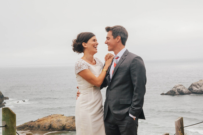 bride and groom oceanside portrait