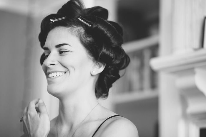 bride with her hair in rollers