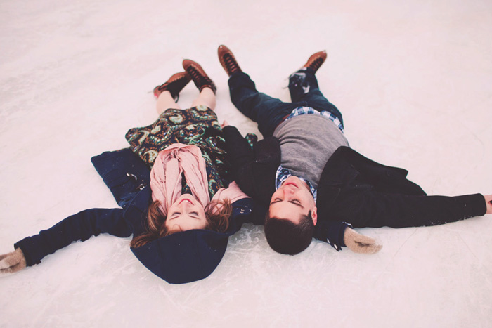 couple lying on the ice