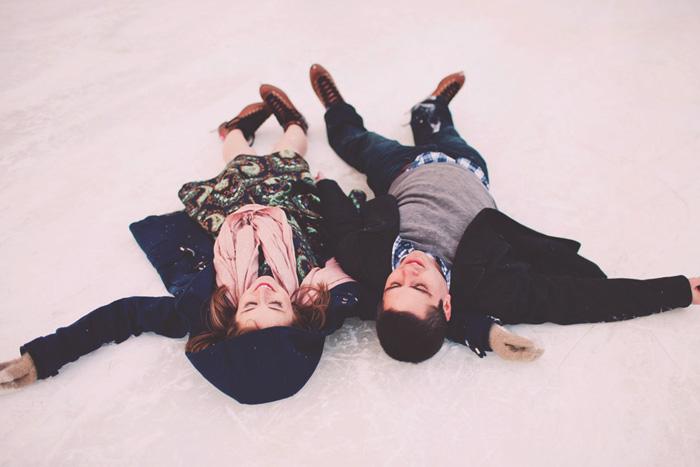couple lying on the ice