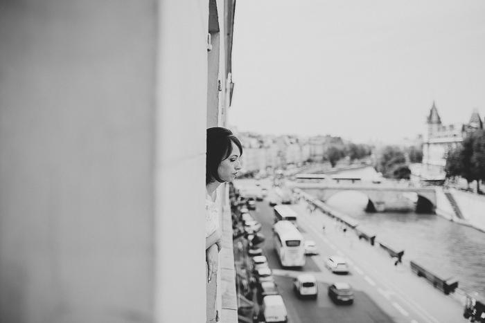 bride looking out Paris window