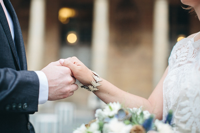 bride and groom holding hands while exchanging vows