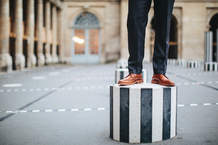 groom standing on striped concrete