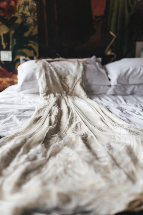 BHLDN wedding dress on bed