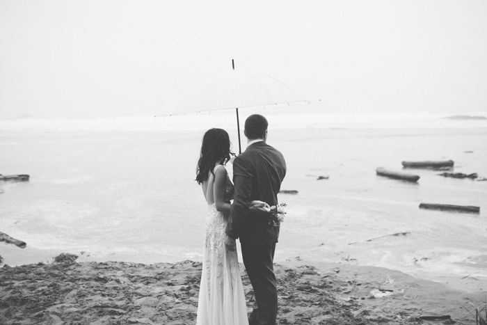 bride and groom looking out to the ocean