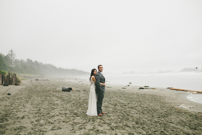 bride and groom on foggy beach