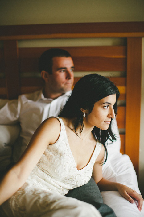 bride and groom sitting on the bed