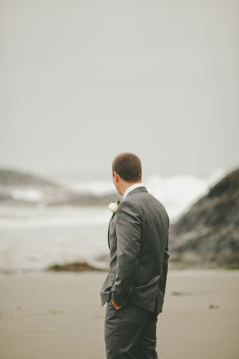 groom waiting on the beach for his bride