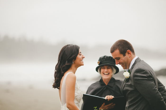 bride and groom laughing during elopement ceremony