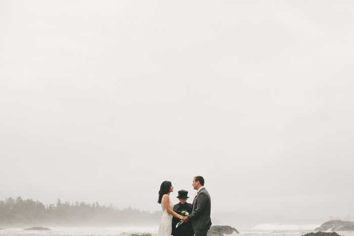 rainy elopement ceremony on the beach