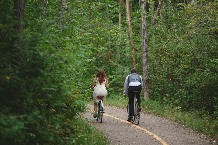 bride and groom riding down the road