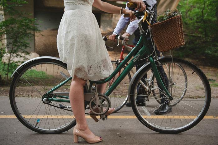 bride and groom on bikes