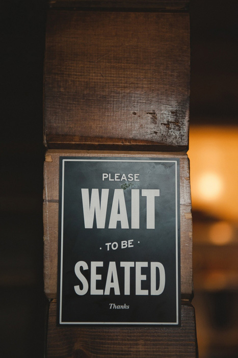 wait to be seated sign