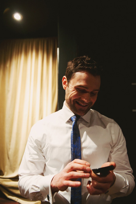 groom reading a text message
