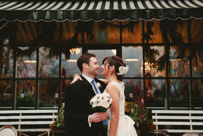 bride and groom portrait outside of store