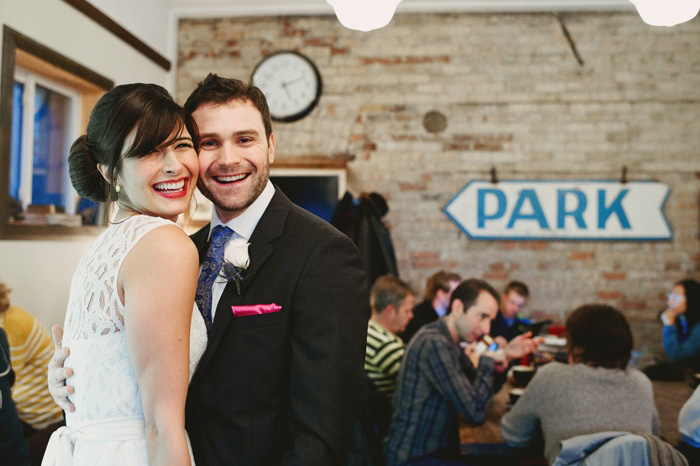 bride and groom portrait in a coffee shop