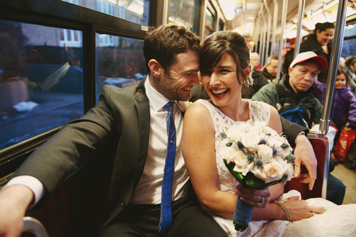 bride and groom riding the streetcar