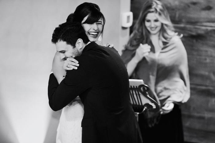 groom hugging bride during ceremony