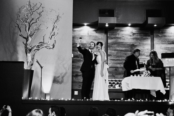 bride and groom taking selfie after ceremony