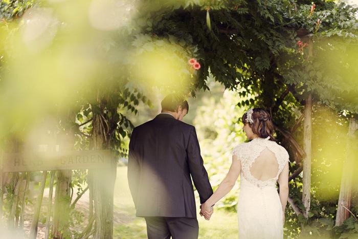 bride and groom walking hand inhand