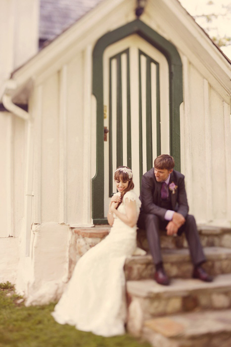 bride and groom on chapel steps