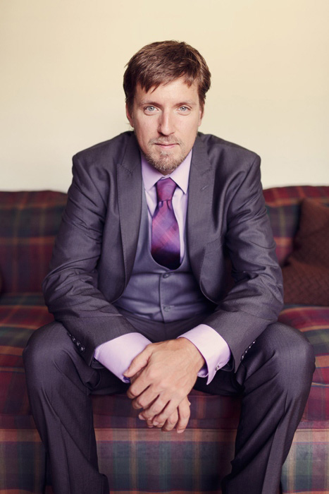 groom in purple shirt and tie