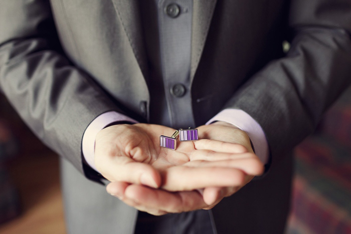 groom with purple cuff links