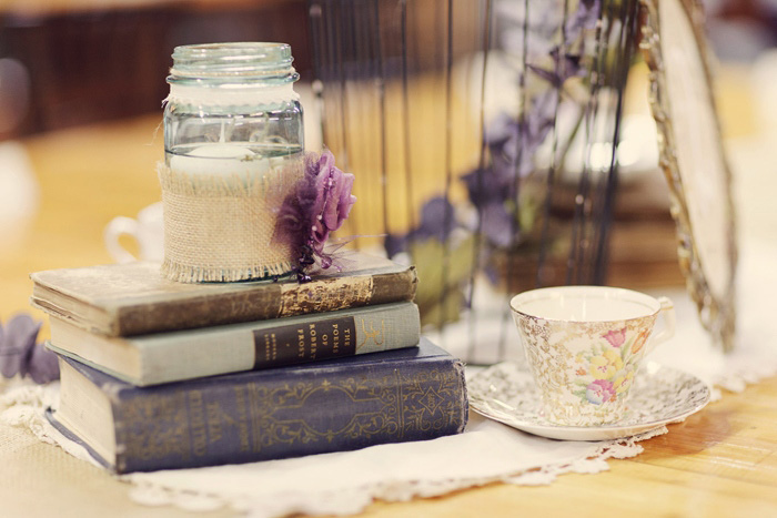 antique books and mason jar centerpiece