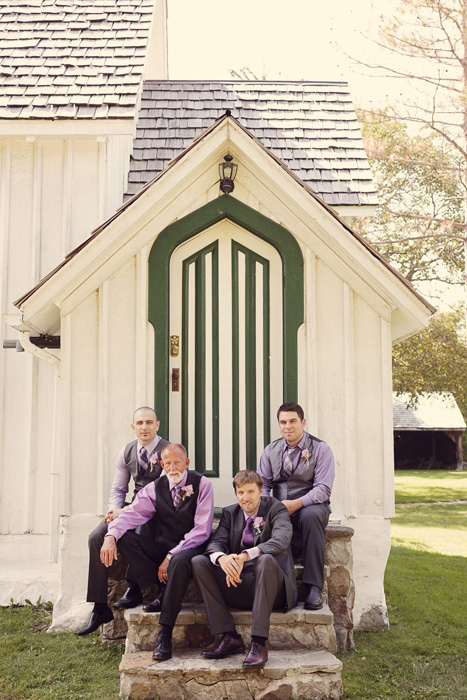 groomsmen sitting on stone steps