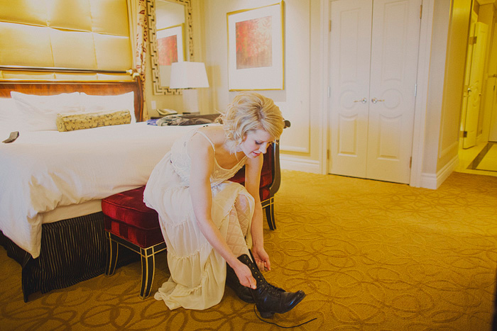 bride lacing up her boots