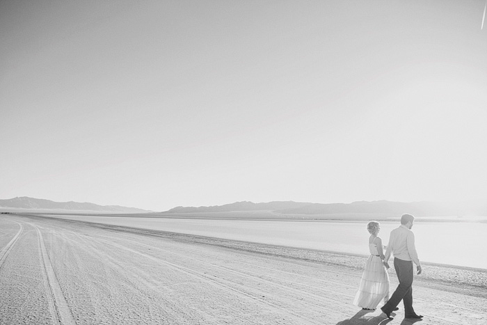 bride and groom walking across nevada road