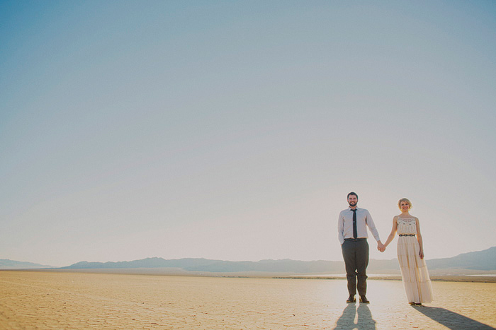 bride and groom standing in dry lake bed