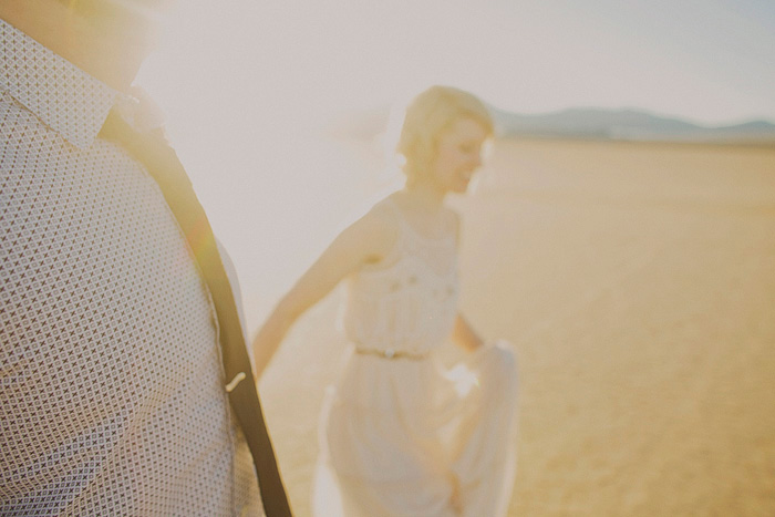 bride walking through the desert