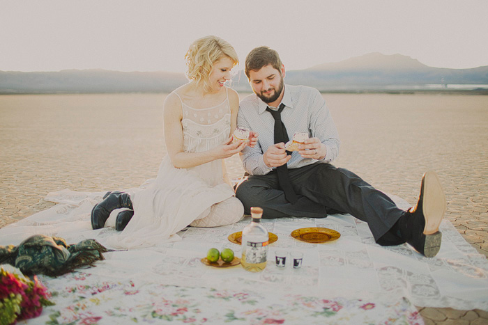 bride and groom having a picnic in the desert