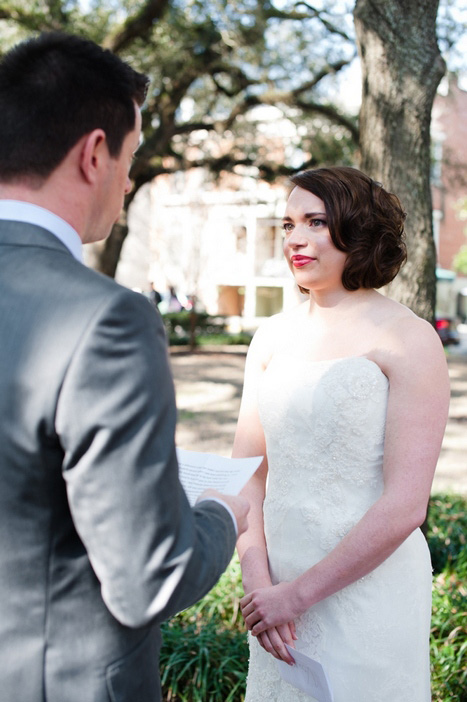 bride listening to groom's vows