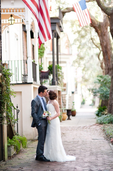 bride and groom kissing in the street