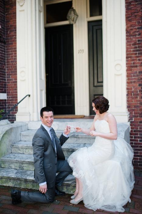 bride and groom holding garter