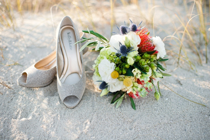 bouquet and shoes on the beach