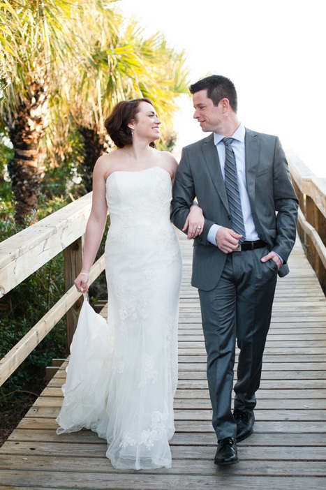 bride and groom walking on the boardwalk