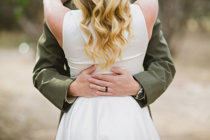 groom huggin bride