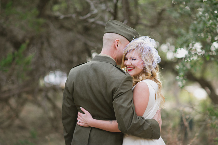 groom whispering in bride's ear
